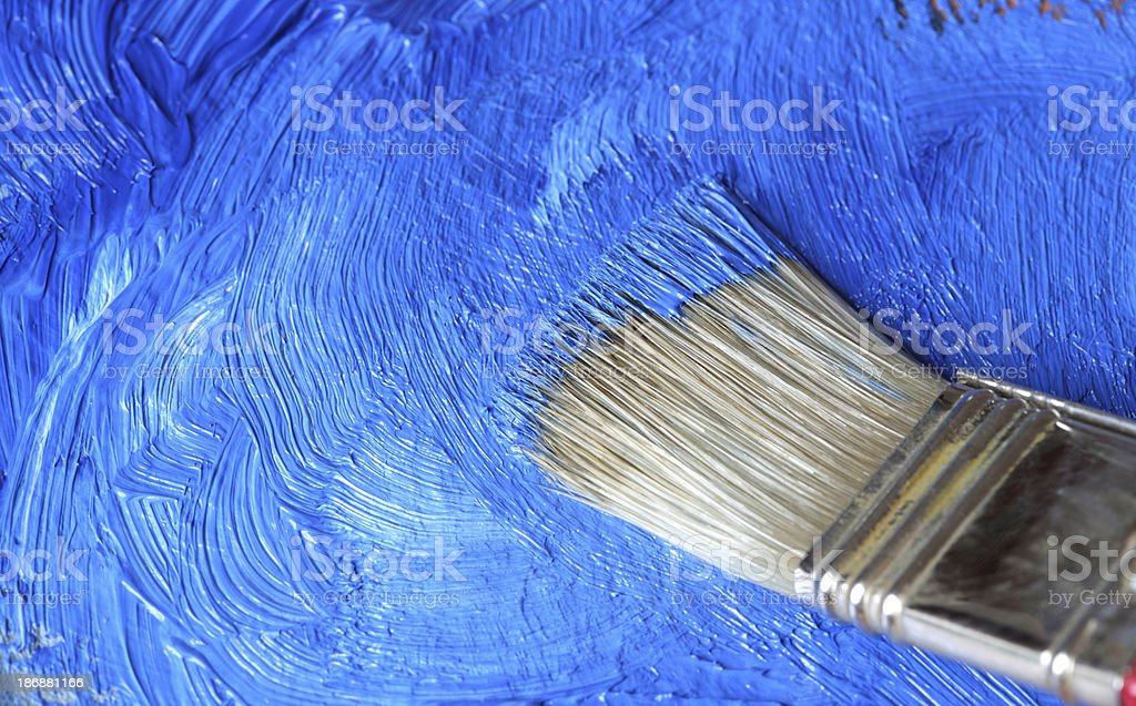 Paintbrush with Cobalt blue oil paint on a classical palette royalty-free stock photo