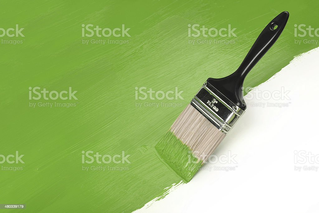 Paintbrush With Greeen Paint stock photo