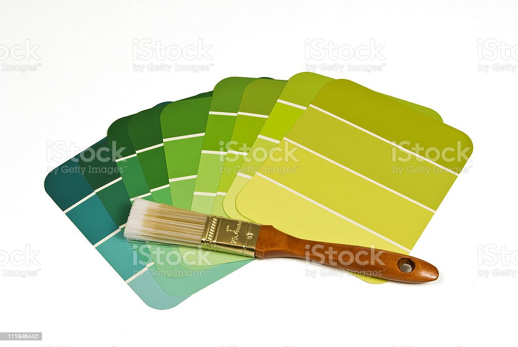 Paintbrush With Green Paint Samples royalty-free stock photo