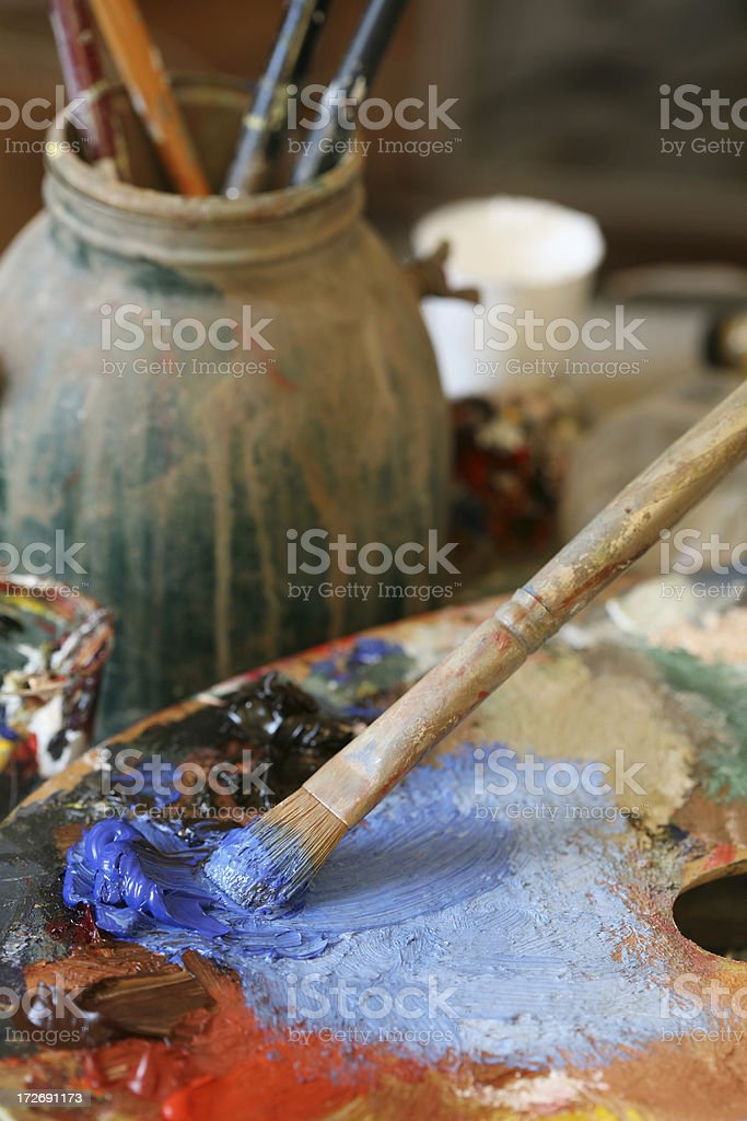 Paintbrush with oil paint in the Artist's Studio royalty-free stock photo