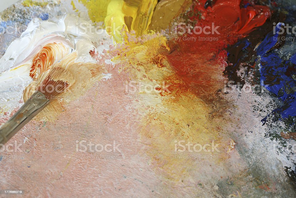 Paintbrush with oil paint on a classical palette royalty-free stock photo