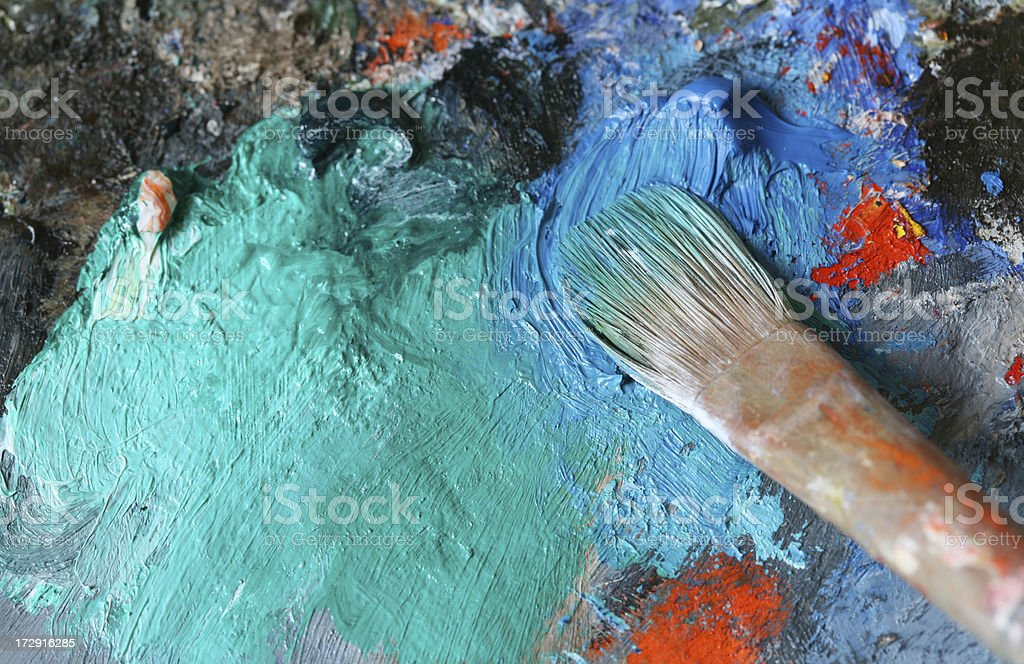 Paintbrush with oil paint on a classical palette - XL royalty-free stock photo