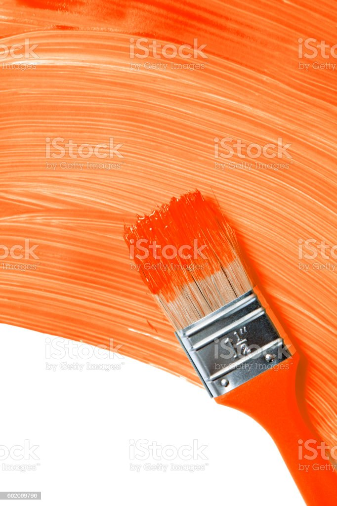 Paintbrush with orange paint stock photo