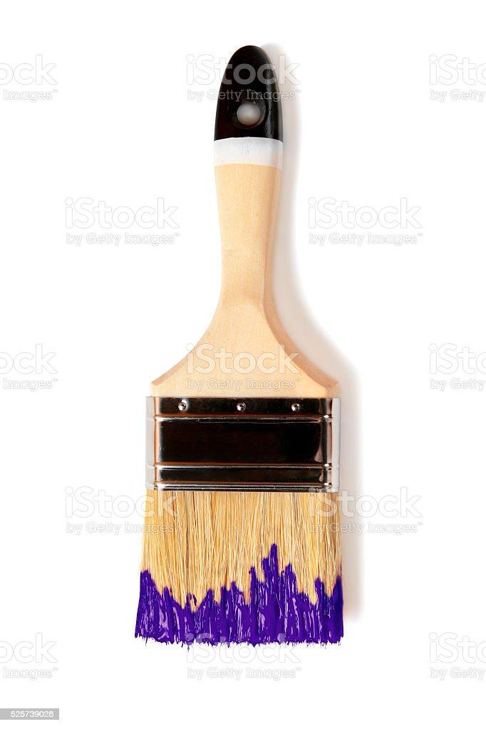 Paintbrush with purple paint (isolated on white) stock photo