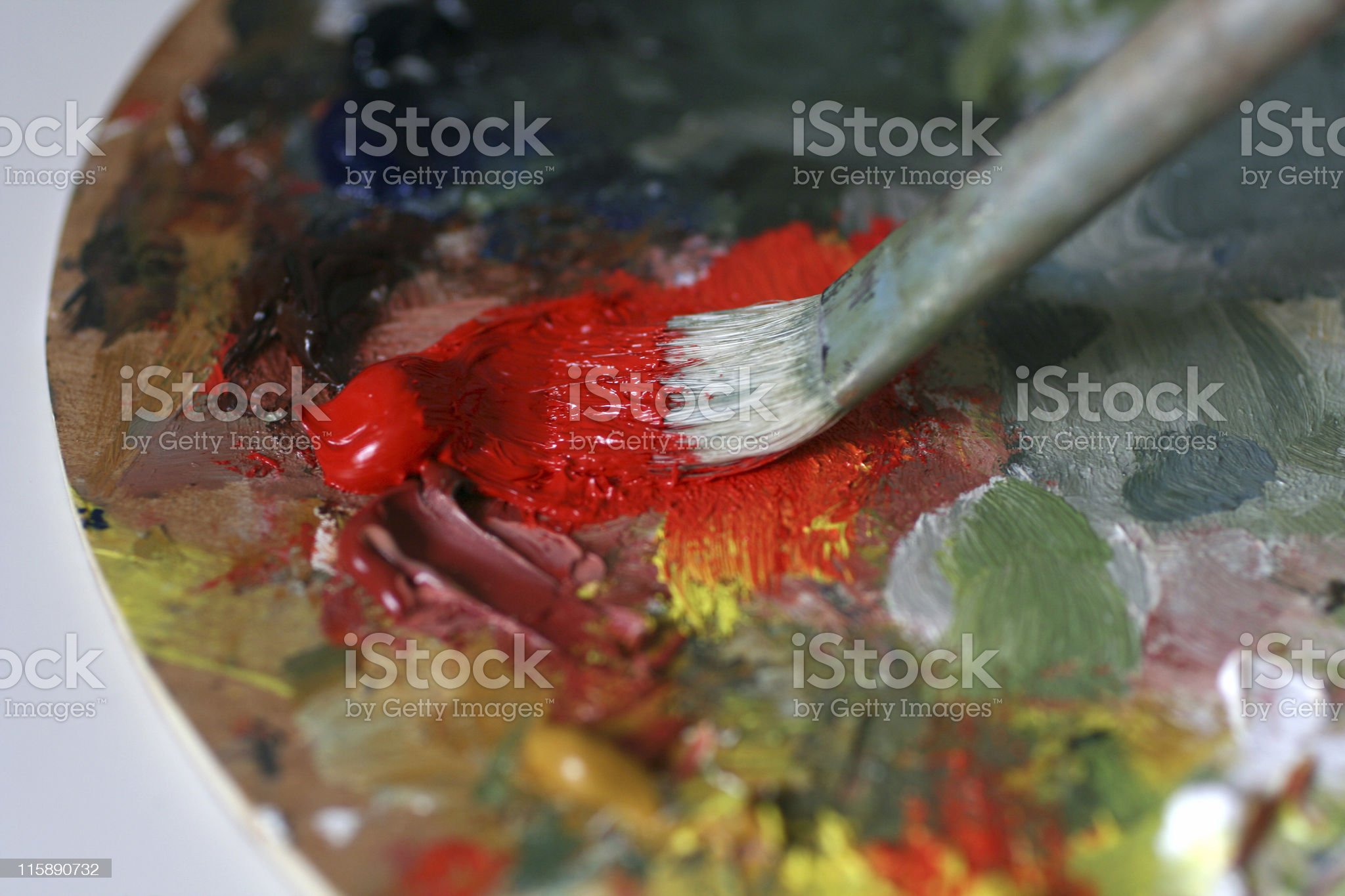 Paintbrush with red oil paint royalty-free stock photo