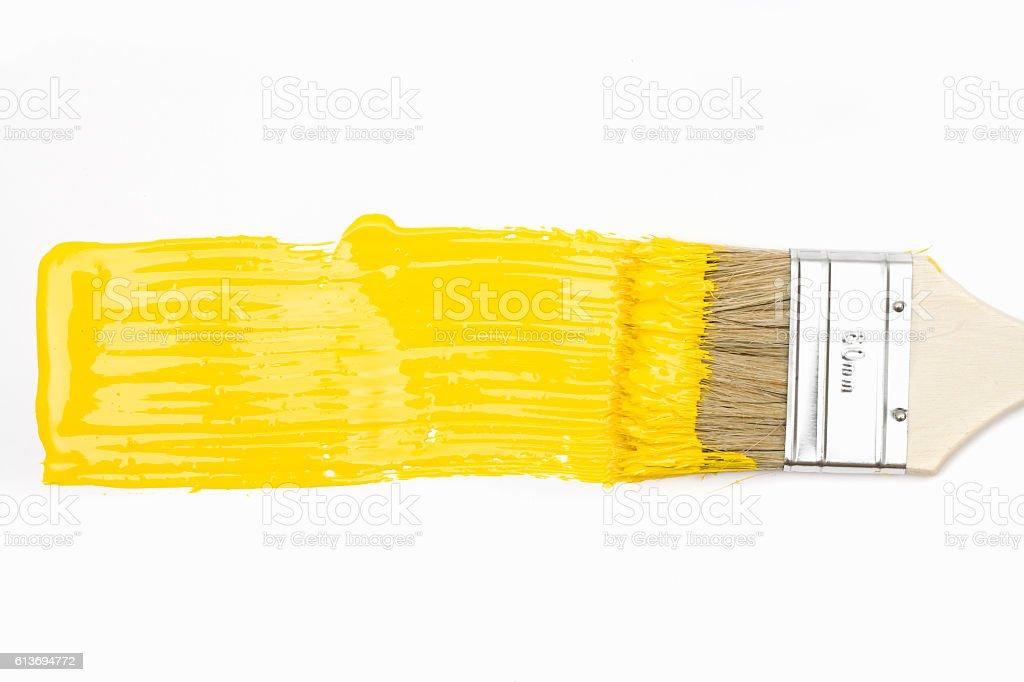 Paintbrush with yellow paint stock photo