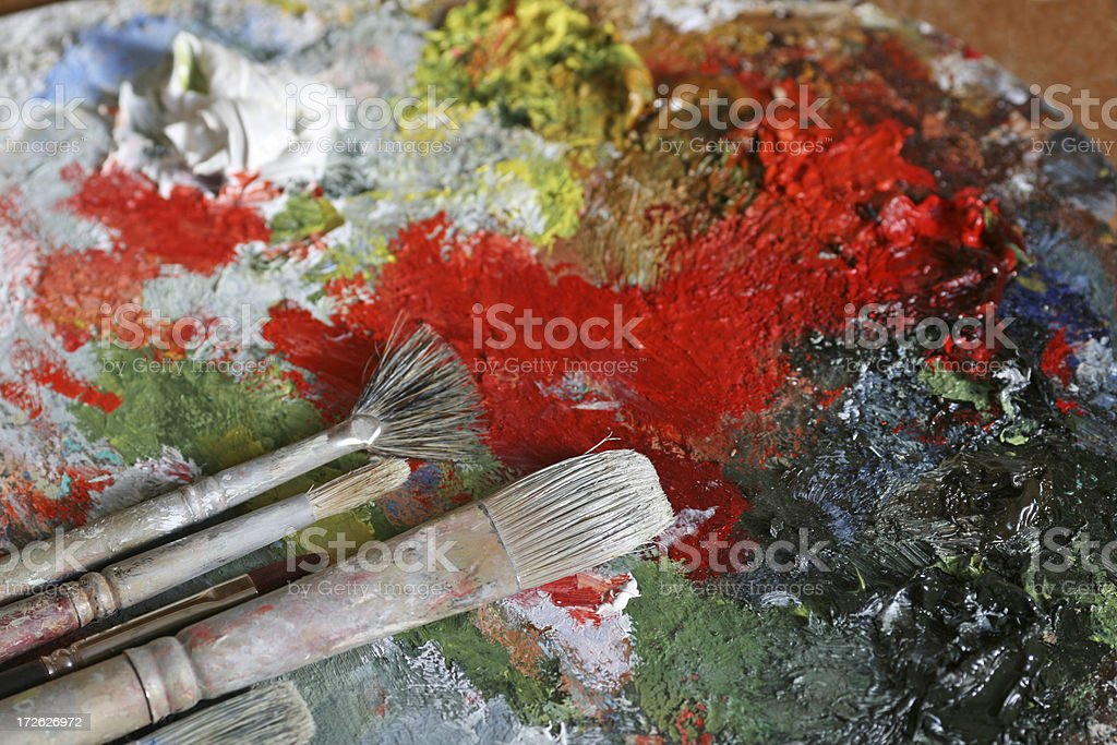 Paintbrushes and a classical palette with oil colors royalty-free stock photo