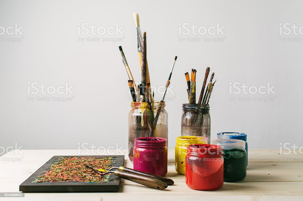 Paintbrushes and colors stock photo