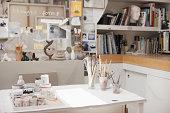Paintbrushes in jars in art studio