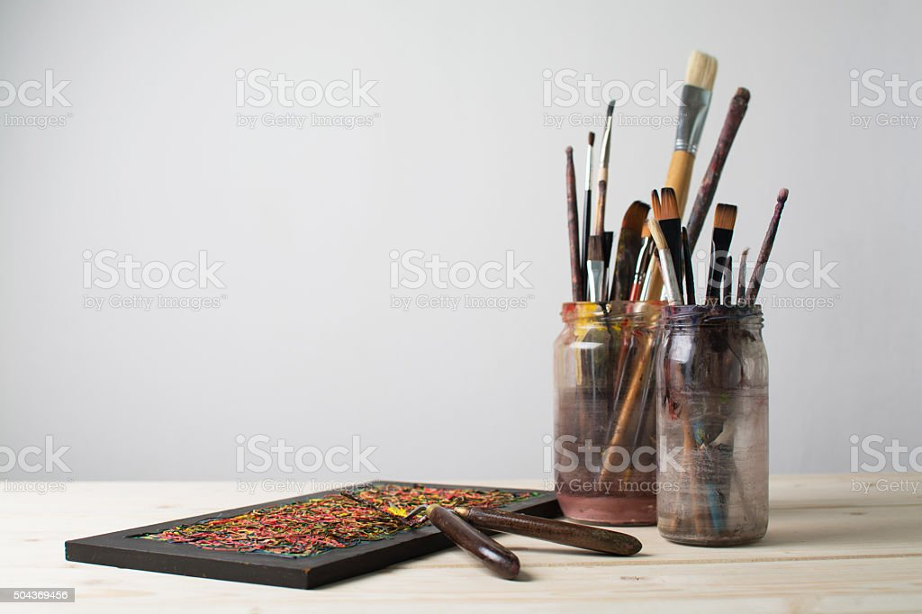 Paintbrushes on a table stock photo