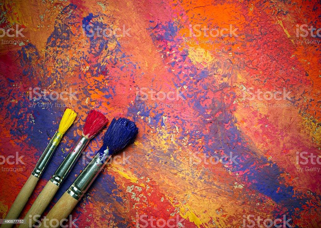 Paintbrushes on abstract grange background stock photo