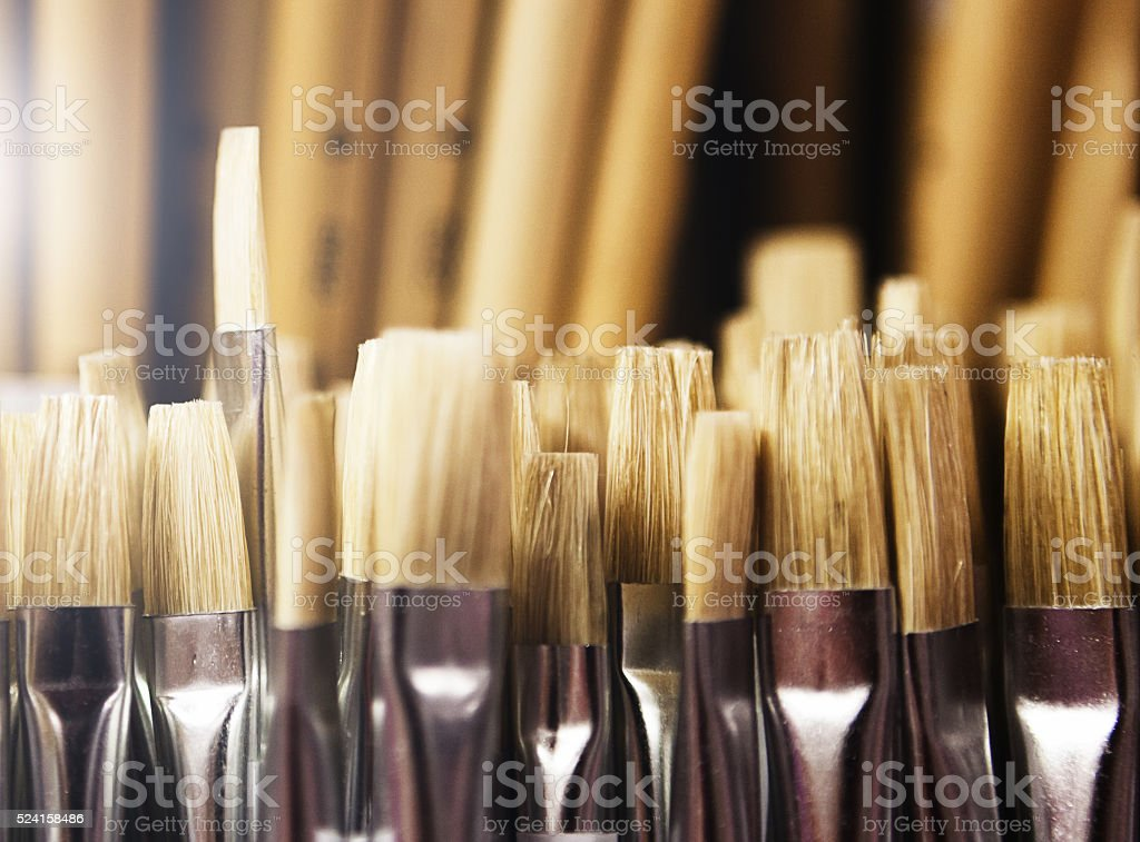 Paintbrushes on display in art supply store stock photo