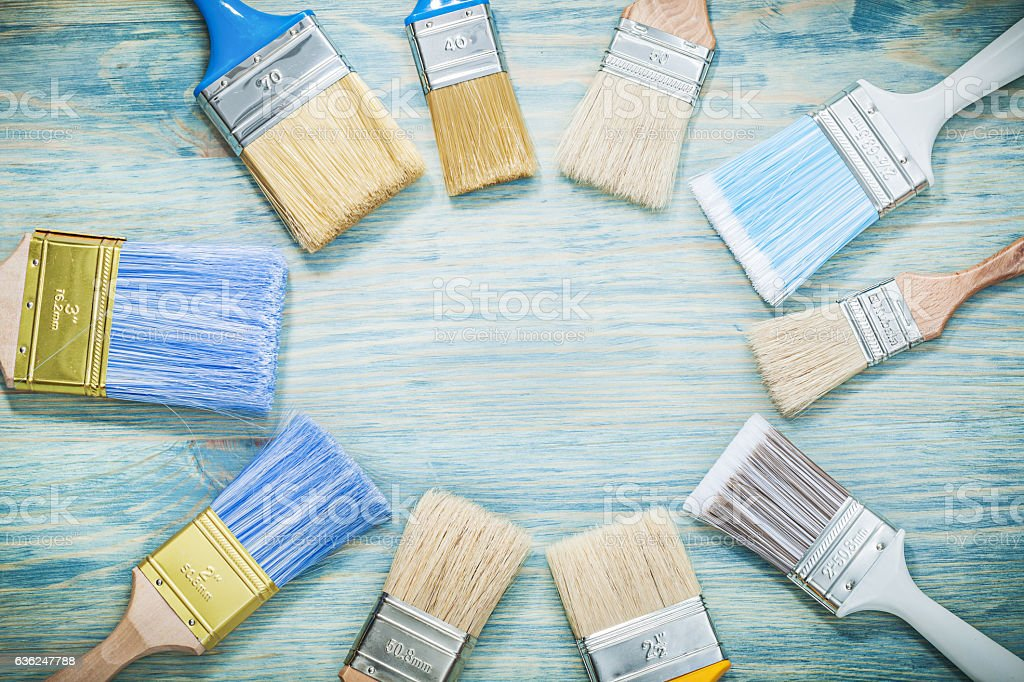 Paintbrushes on wooden board construction concept stock photo