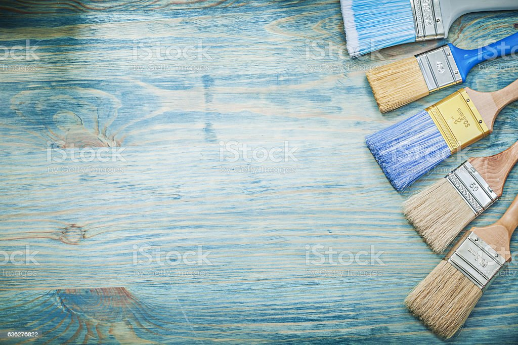 Paintbrushes on wooden board copy space construction concept stock photo