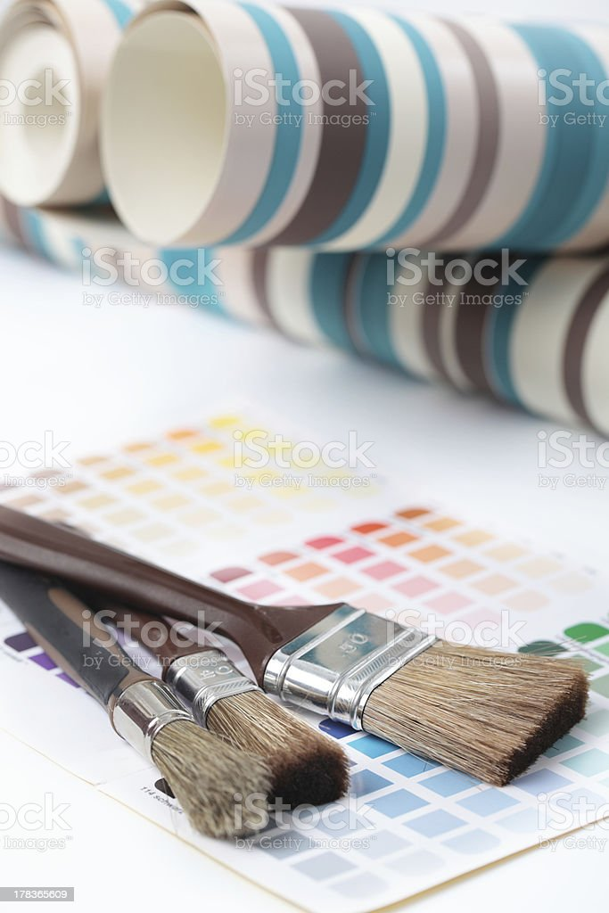Paintbrushes, wallpapers, and color swatch stock photo