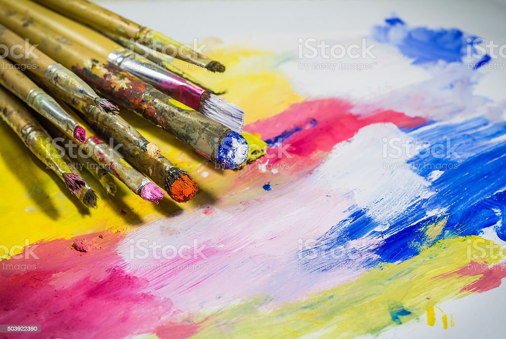 Paintbrushes with color on paper stock photo