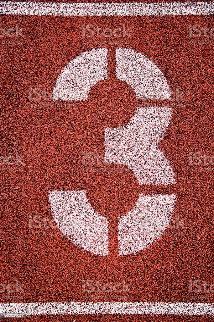 Painted '3' on running track stock photo