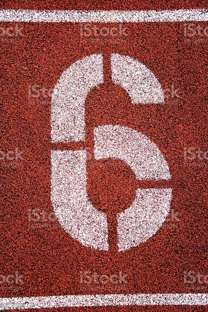 Painted '6' on running track stock photo