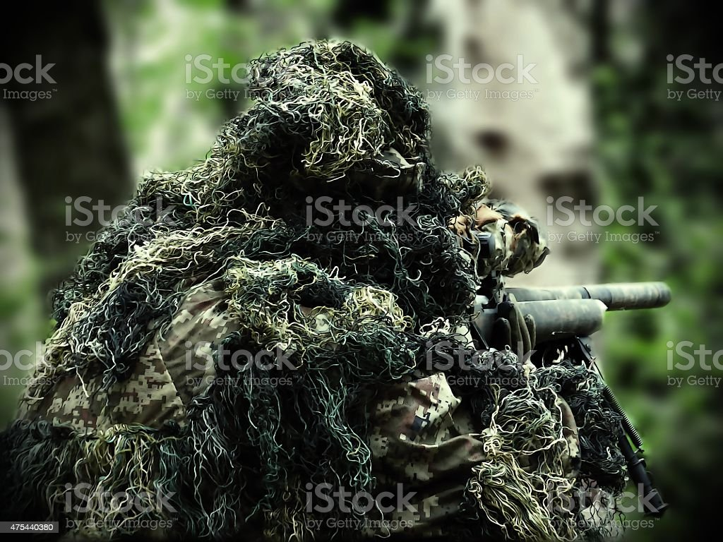 painted airsoft player with Ghillie Suit stock photo