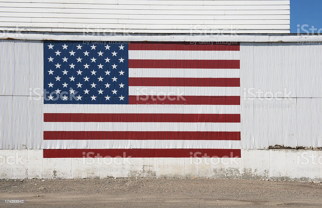 Painted American Flag on Industrial Wall in Western USA stock photo
