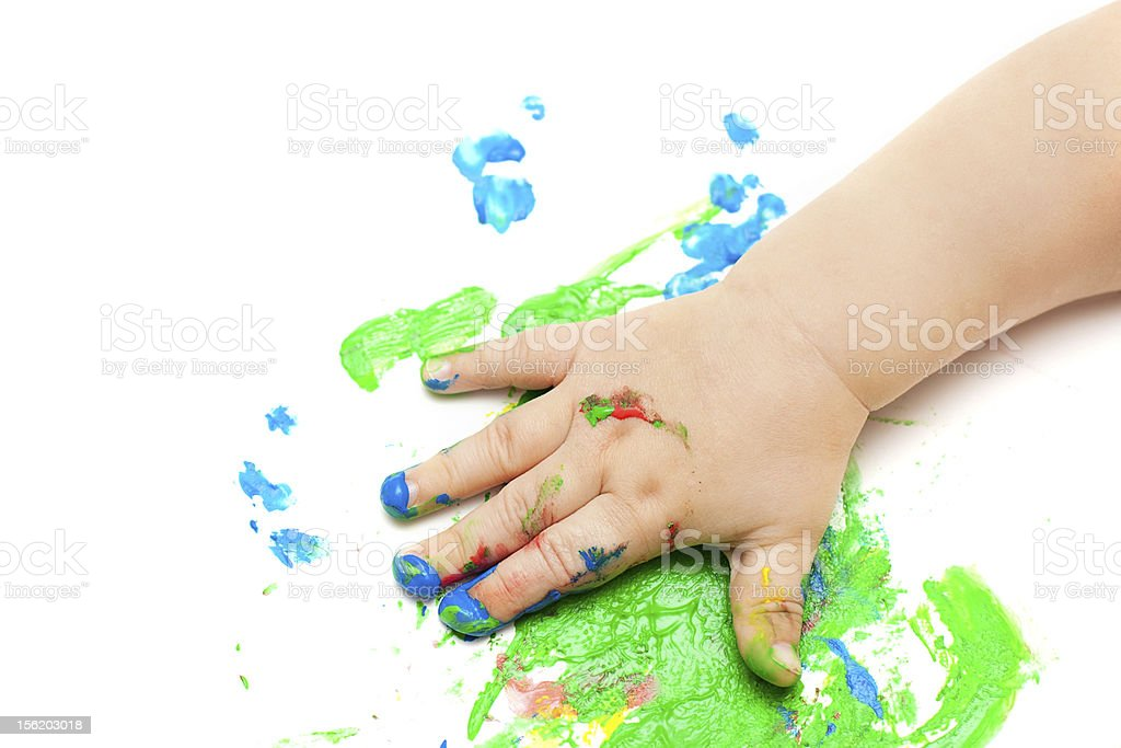 painted baby hand stock photo