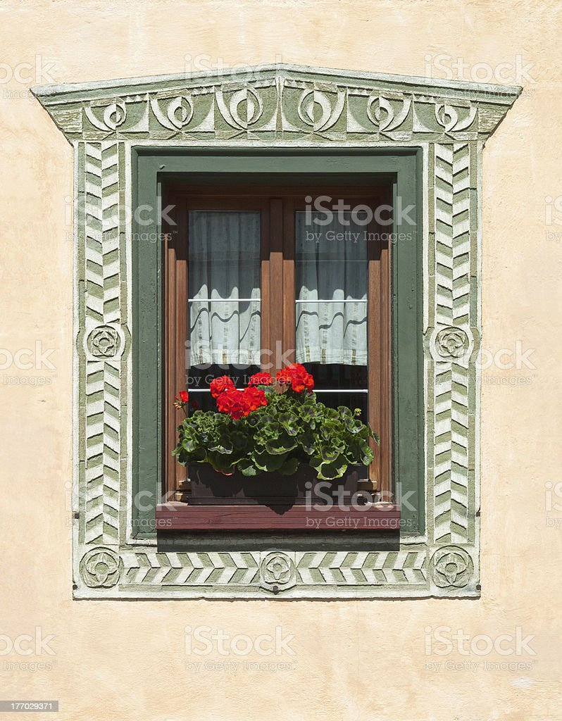 Painted Bas Relief Window, Dolomites, Italy stock photo