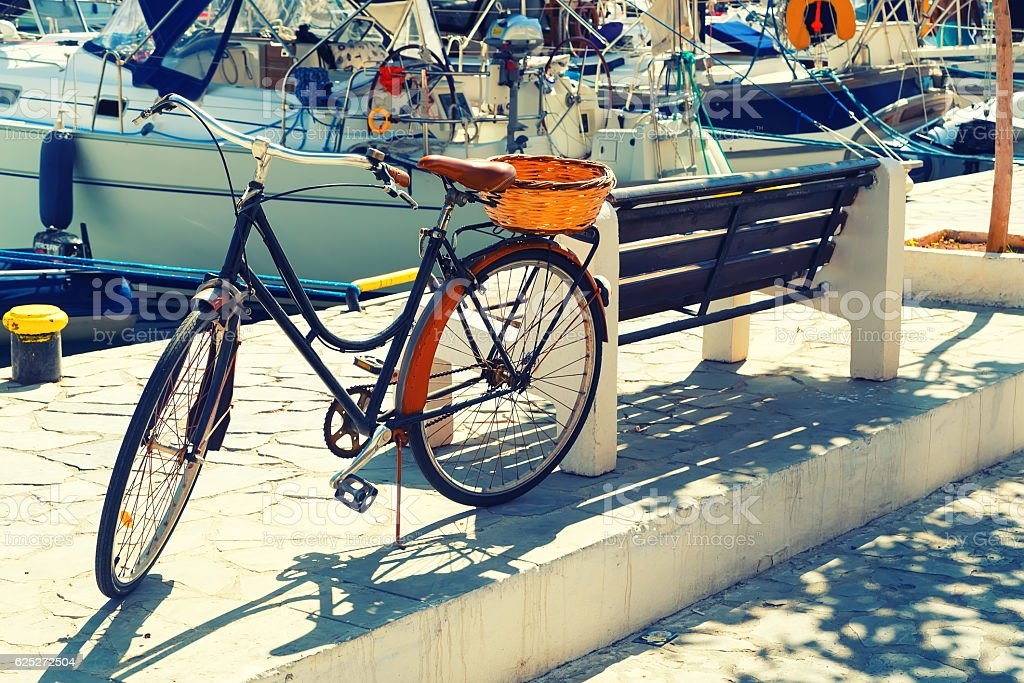 Painted Bicycle on Embankment of Simi, Greece, Retro Effect stock photo