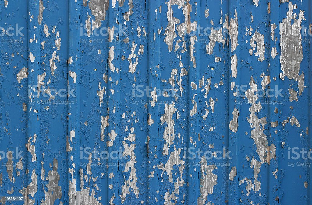 Painted blue flaked corrugated metal sheet stock photo