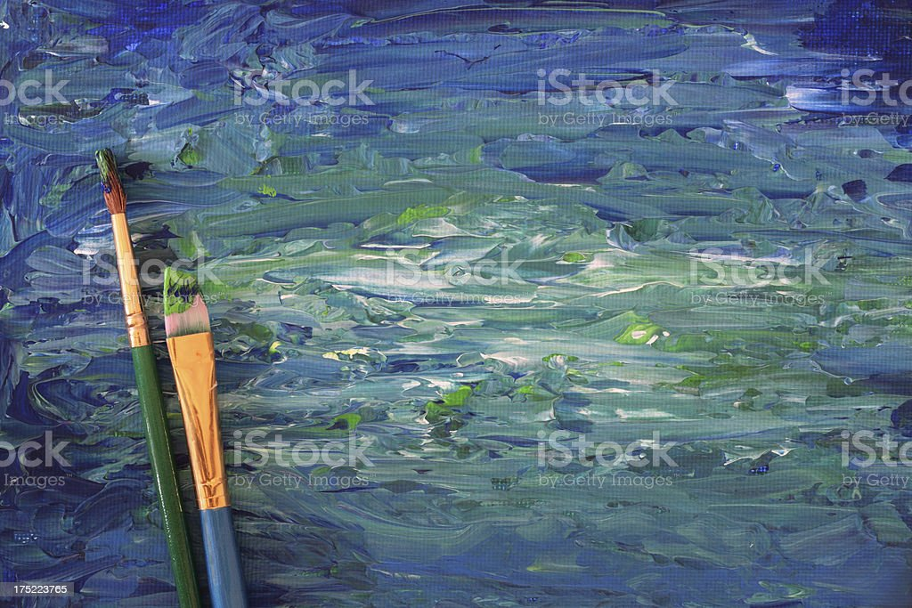 Painted canvas with brushes - Horizontal stock photo