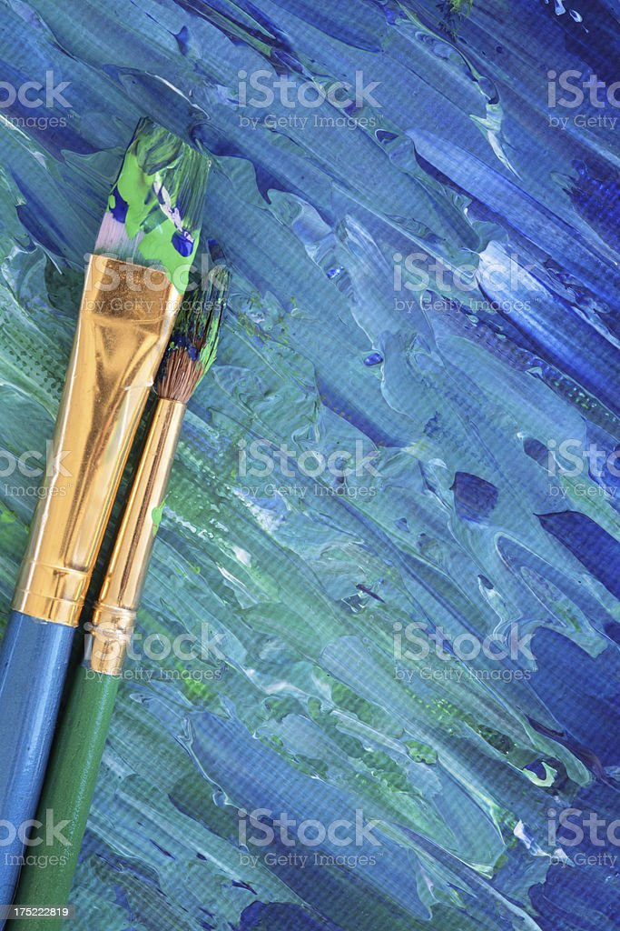 Painted canvas with brushes - Vertical royalty-free stock photo