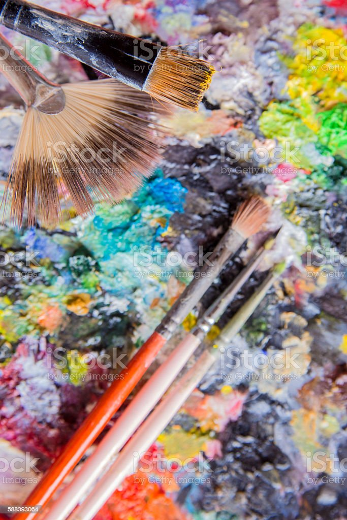 Painted canvas with brushes - Vertical stock photo