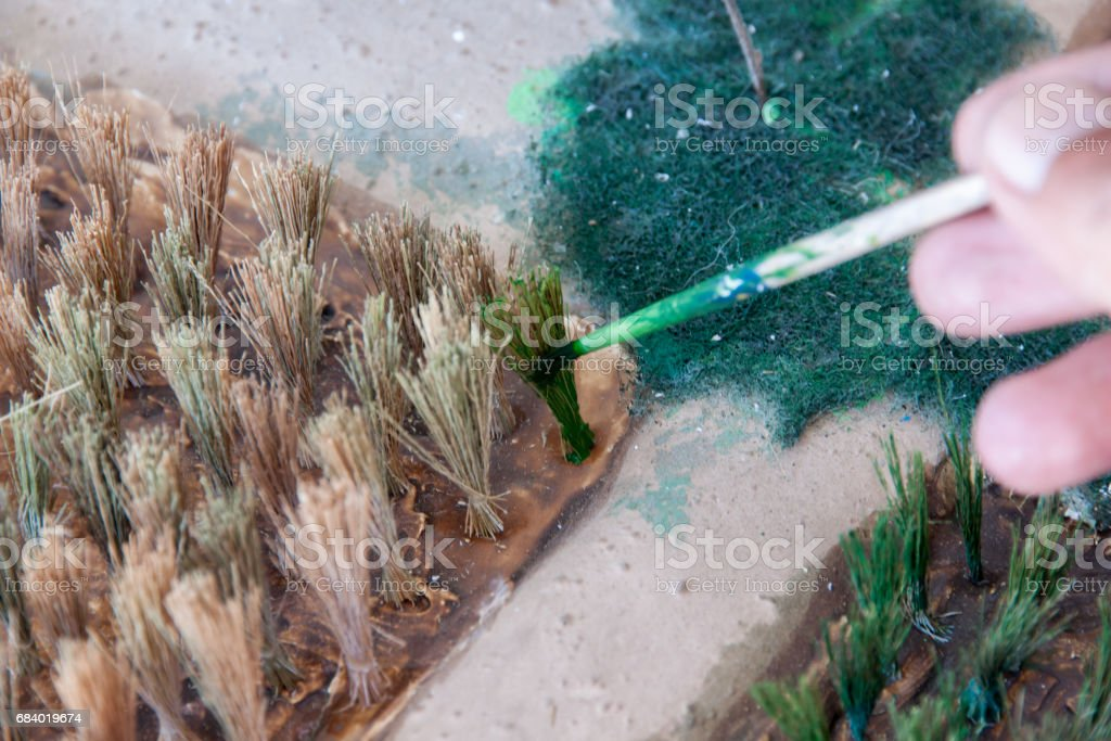 Painted color the make a planting rice model stock photo