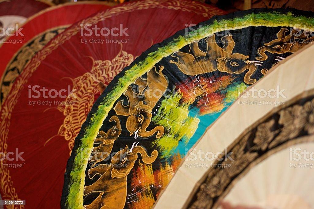 Painted cotton umbrellas stock photo