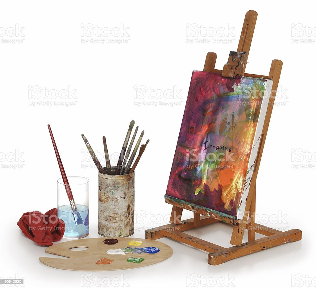 Painted desktop canvas with painting materials stock photo