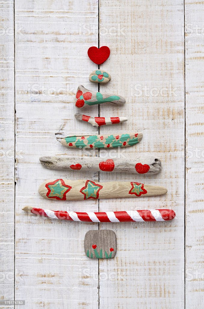 Painted driftwood Christmas tree on textured wood royalty-free stock photo