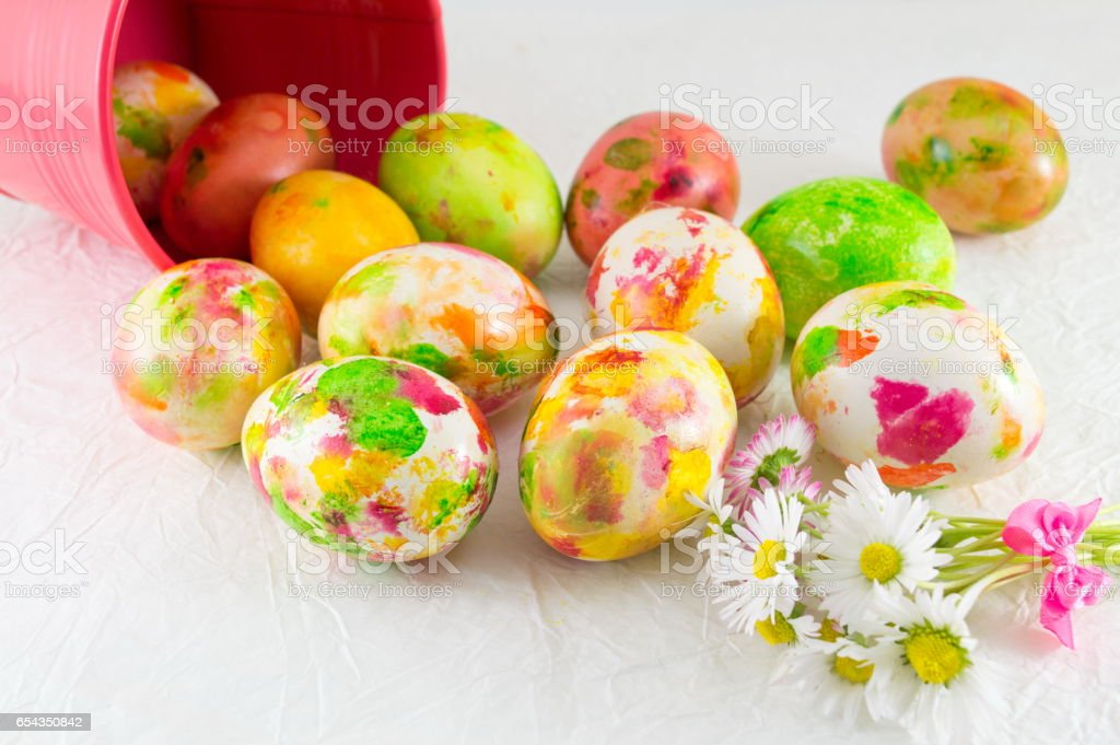Painted Easter eggs and daisy flowers stock photo