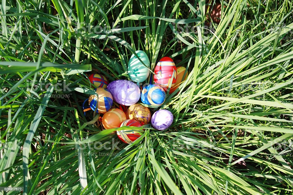 painted easter eggs in green the grass stock photo