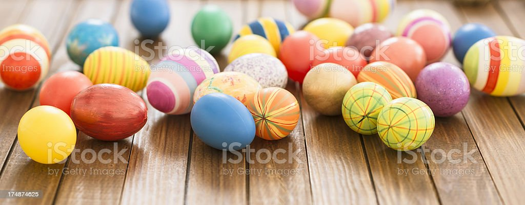 painted easter eggs on wood background royalty-free stock photo