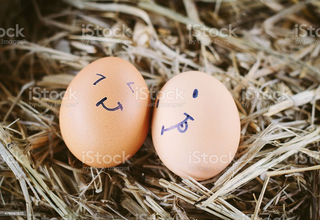 Painted  eggs about emotion on the face stock photo
