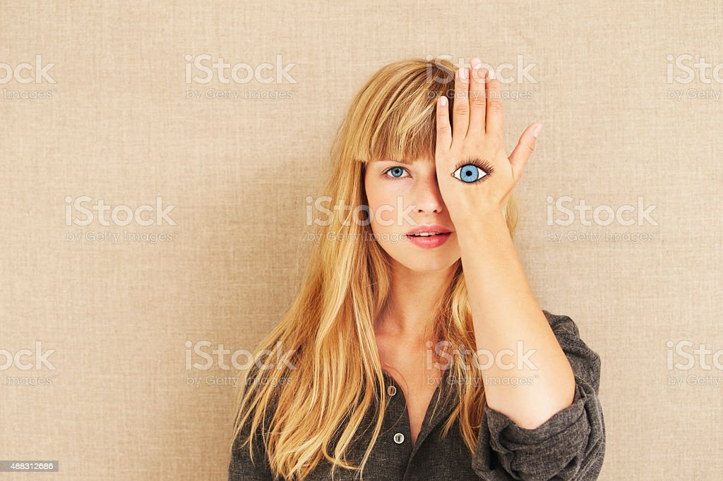 Painted eye on beautiful blond stock photo