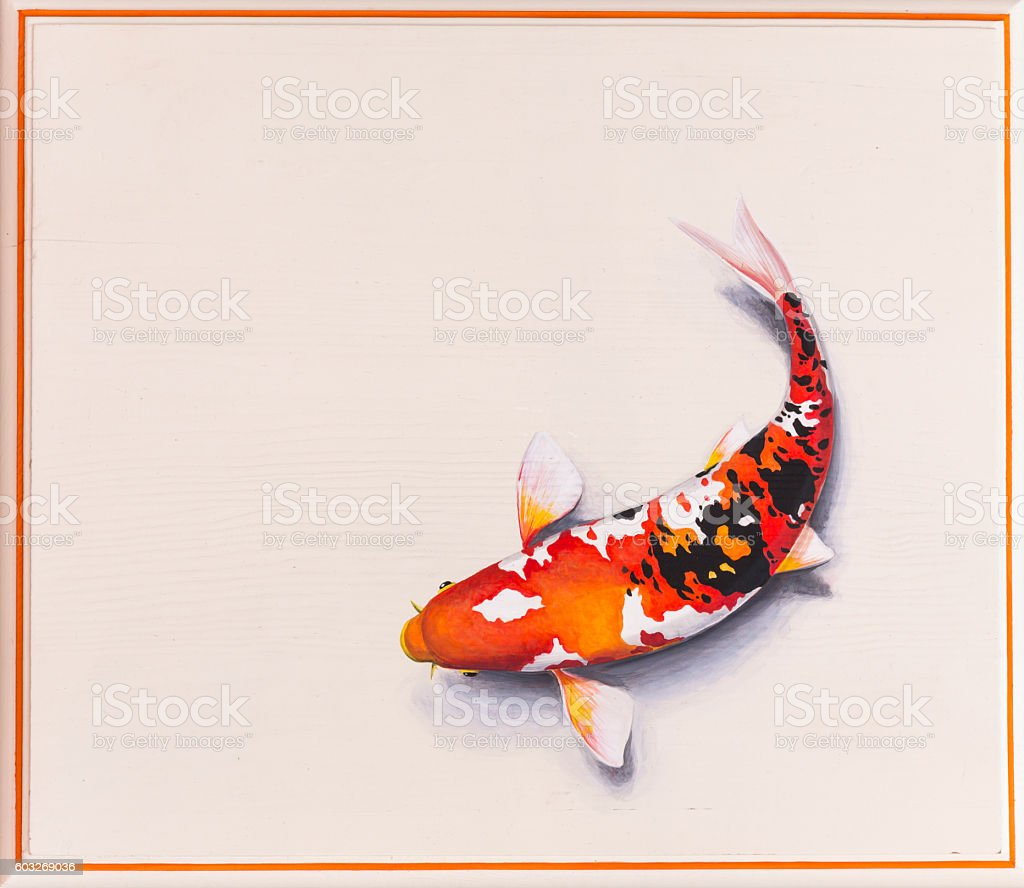 painted fish on stone stock photo