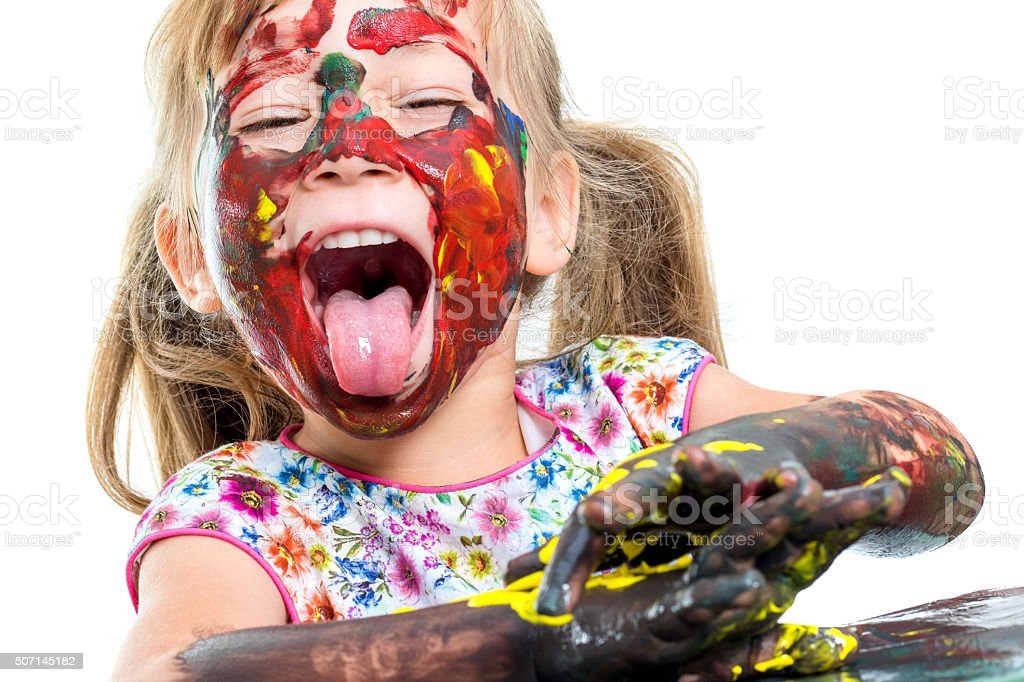 Painted girl pulling out tongue. stock photo