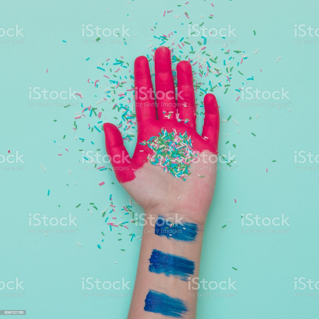 Painted hand with confetti stock photo