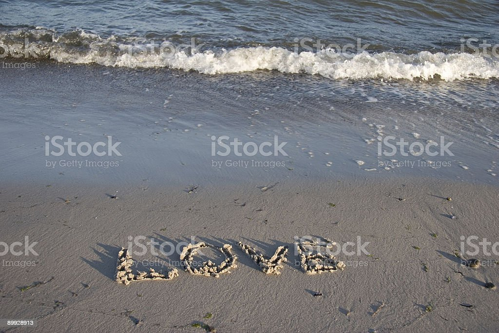 LOVE painted in sand royalty-free stock photo