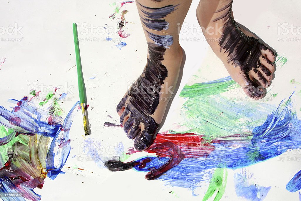 Painted Kid's Feet on Art Project royalty-free stock photo