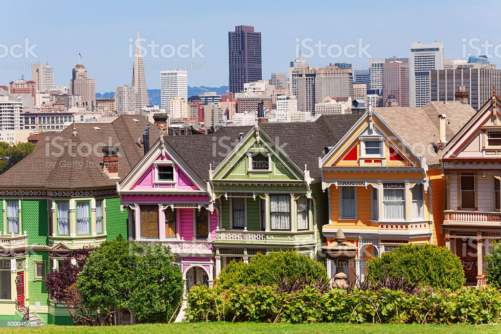 Painted ladies from Alamo square and SF skyline stock photo