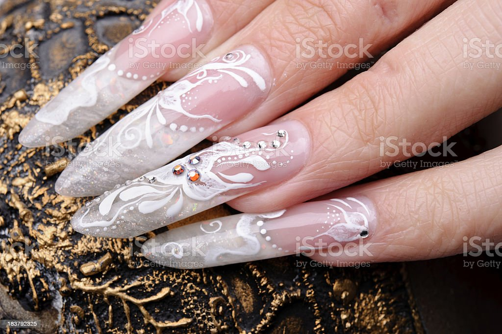 beautiful painted nails in gold backgrounds.