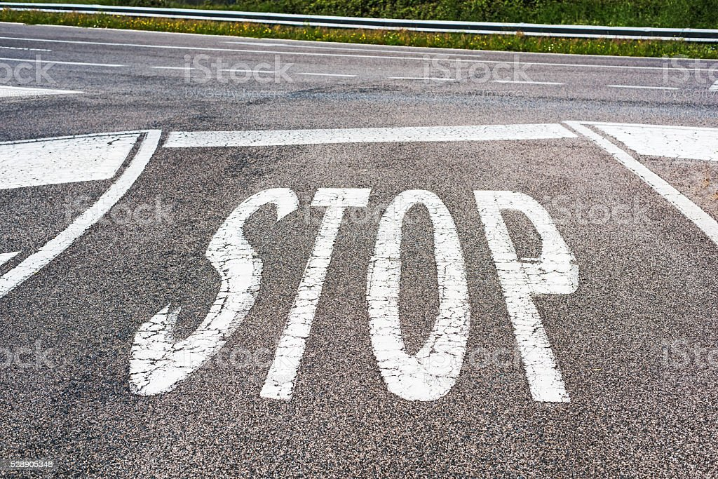 'STOP' painted on a country road stock photo