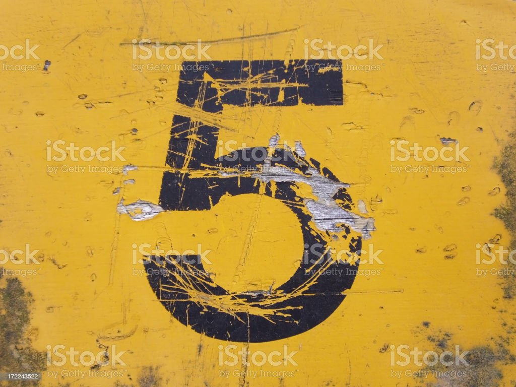 A painted on number 5 scratched out stock photo
