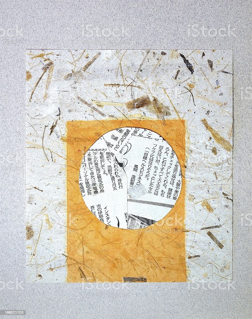 Painted rice paper with fragments of Japanese newspaper stock photo